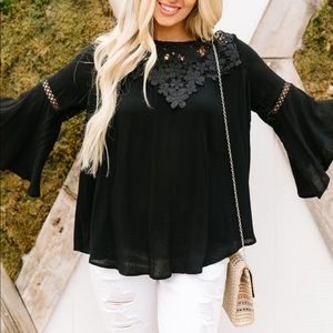Girl in Black Embroidered Blouse